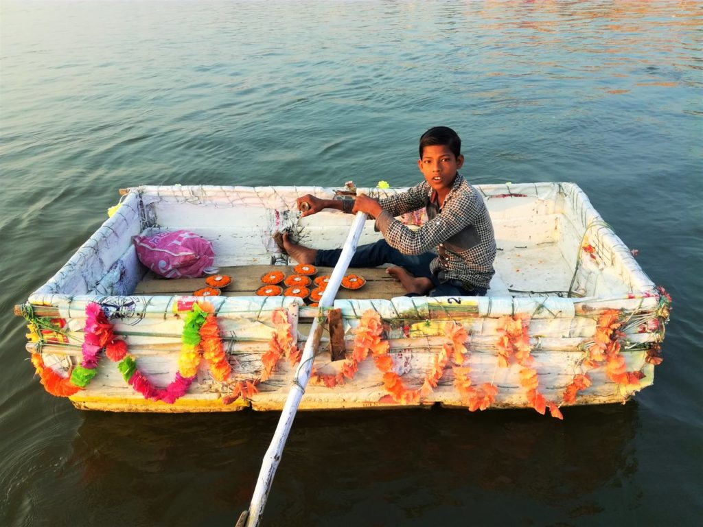 Selling lamps on the Ganges